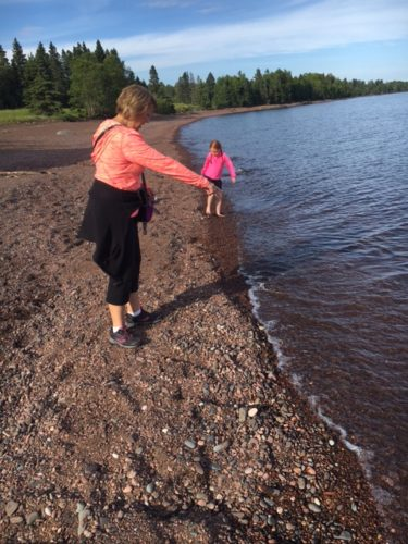 Elise and mom searching for rocks